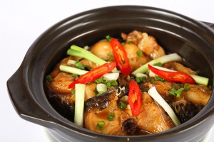 Braised basa fillet in a clay pot